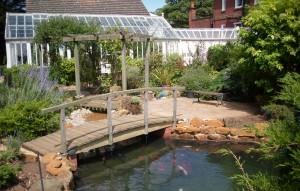 Koi pond with stream and timber bridge for Michael koi pond